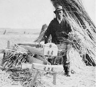 A hand hemp breaker being used in the field
